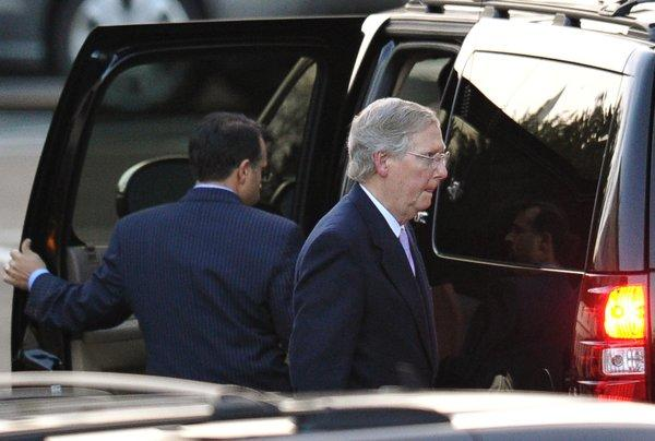 "Senate Minority Leader Mitch McConnell (R-Ky.) departs from the White House after talks with President Obama aimed at avoiding the ""fiscal cliff."""