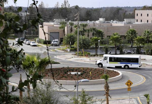 With the construction of the roundabout at the intersection of Main Street and Sinclair Avenue in downtown Tavares now complete, the Lake County Public Transportation Division will immediately resume use of its two LakeXpress bus stops on Main Street along Route 1 near the Lake County Administration Building. (Tom Benitez/Orlando Sentinel)