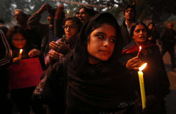 Indians holding a candlelight vigil Wednesday as the victim of a brutal gang rape in New Delhi continued to deteriorate. She died at a Singapore hospital early Saturday.