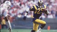 Eric Dickerson rushed for an NFL single-season-record 2,105 yards in 1984. He ran behind an offensive line that included Doug Smith, Orange Coast College's offensive line coach.
