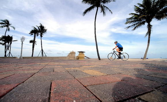 A bike rider enjoys a quiet morning on the Hollywood beach broadwalk.