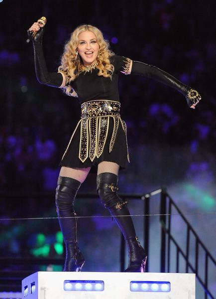 "If you're Madonna and you plan to stage the most fashionable Super Bowl halftime show in years, there's only one way to kick it off: Perform the 1990 smash hit 'Vogue' as classic Vogue covers are projected on stage. The Queen of Pop's performance featured numerous costume changes and included Givenchy couture, Bulgari jewelry, custom stretch leather Miu Miu boots and a glittering headpiece by star milliner Philip Treacy. But all was almost overshadowed when rapper M.I.A. had a ""finger malfunction"" during the show and accidentally flipped off everyone who was watching. (February)"