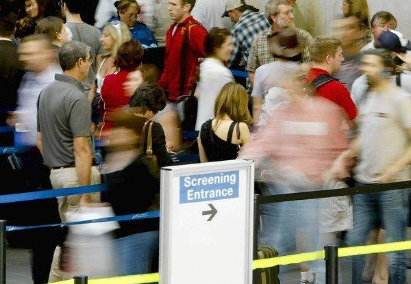 Passengers at Los Angeles International Airport line up for security screening.