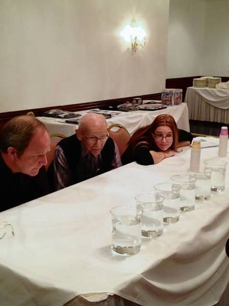 The three judges for the annual Kane County best-tasting water contest examine the 10 samples.