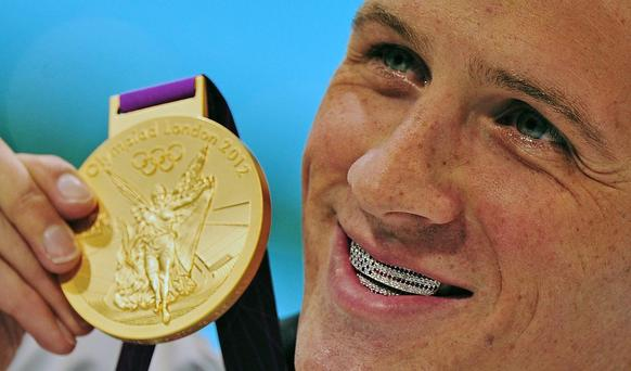 When American swimmer and fashion lover Ryan Lochte won his first gold medal, he stepped up to the podium and gave a big grin -- revealing a custom made jewel-encrusted American flag dental grill. The United States looked on, embarrassed. Lochte bared more than that when he was photographed on Vogue's June cover running arm in arm on a beach with fellow Olympians Serena Williams and Hope Solo, all clad in tasteful bathing suits. (June, July)