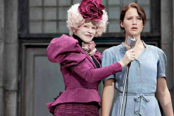 "The style-obsessed world of the popular YA novel ""The Hunger Games"" was brought to life on screen by costume designer Judianna Makovsky, with a cast of hundreds dressed in everything from utilitarian garb with Depression-era grit to glam-gone-grotesque get-ups inspired by the latest haute couture. The character Effie, one part Marie Antoinette and one part Isabella Blow, could barely walk in her shoes -- which was intentional. ""She is a fashion victim,"" Makovsky said. The studio launched a website, Capitol Couture.com, dedicated to fashion inspired by the film, and collaborated with China Glaze on a range of nail polish colors. (March)"