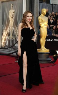 While Gwyneth Paltrow may have won the Oscar style stakes, Angelina Jolie's leg stole the red-carpet show when she struck a suggestive pose in her black Versace gown, slit thigh high. (February)