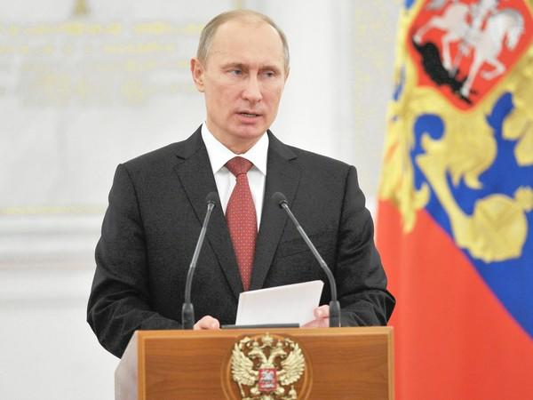Russia's President Vladimir Putin speaks Friday at the Kremlin in Moscow.