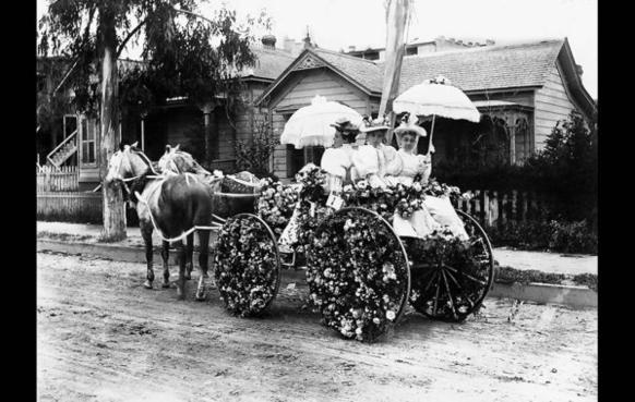 According to caption published in 1957, this flower-decked carriage won first prize in the 1895 Tournament of Roses Parade.
