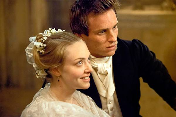 Amanda Seyfried as Cosette and Eddie Redmayne as Marius in 'Les Miserables.'