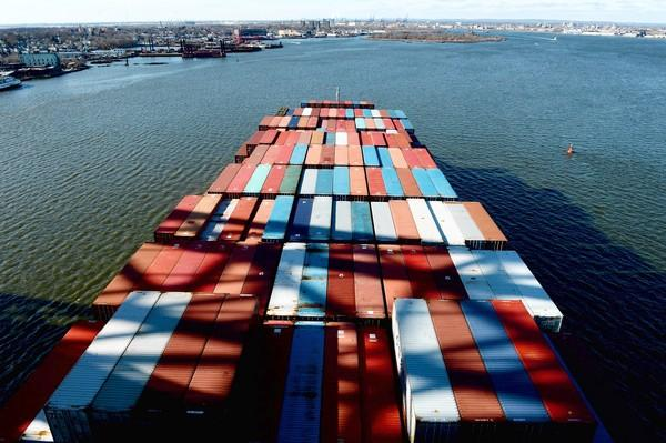 A container ship makes its way into Newark Bay in Bayonne, N.J. A federal mediator announced that a deal has been reached to avert a strike by longshoremen at East Coast ports until at least late January.