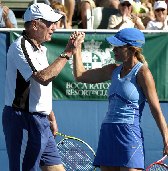 Tennis champion Chris Evert congratulates former President George H. W. Bush on a point well-earned during their match, where they played as doubles partners, in the fourth round of the Chris Evert/ Bank of America Pro-Celebrity Tennis Classic Sunday.