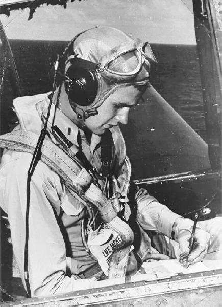 U.S. Navy pilot George Bush sits in the cockpit of an Avenger fighter aircraft, c. 1943-45.