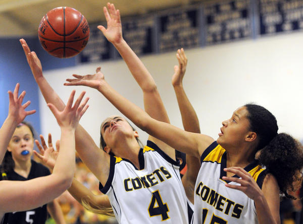 Catonsville senior Deb Milani, center, and sophomomre Maja Wichhart reach for a rebound in the Comets' 37-30 victory over Lower Merion, Pa. on Friday night.