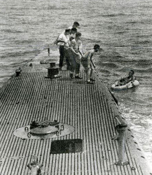 Downed pilot LTJG George Bush is rescued by the Navy submarine, USS Finback on September 2, 1944.