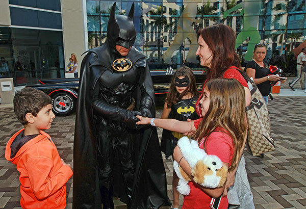 Lenny B. Robinson, dressed as Batman, shakes hands with Madison Lackey, 9, while Fady Khouzam, 6, left, waits his turn to meet the superhero in front of Joe DiMaggio Children's Hospital in Hollywood on Friday, Dec. 28, 2012.