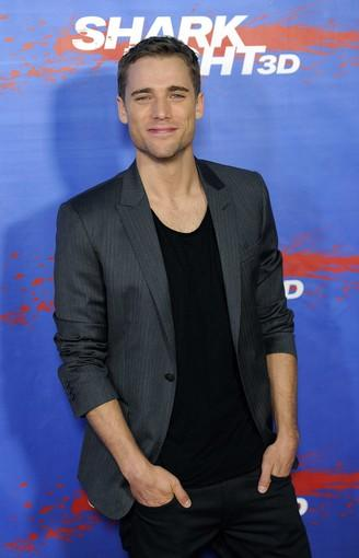 Lead actor Dustin Milligan, who plays Nick in 'Shark Night 3D,' arrives to smile for the cameras at a screening at Universal City Walk. 'Shark Night 3D' releases on Friday.