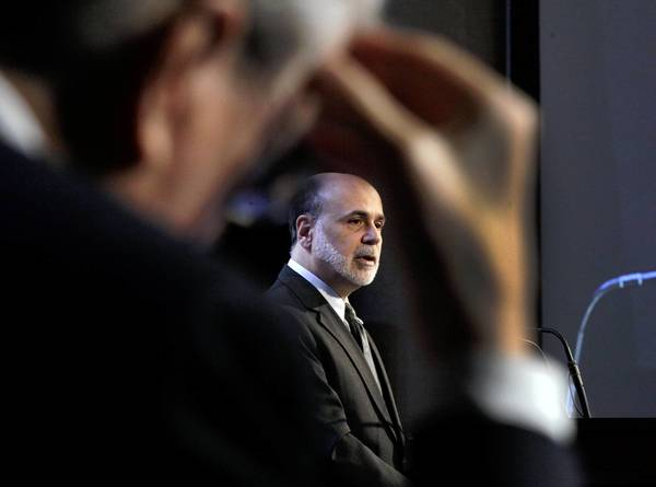Since the financial crisis began in late-2008, the world's major central banks have slashed interest rates to try to prop up the punch-drunk global economy. Above, Federal Reserve Chairman Ben Bernanke addresses a gathering of the Economic Club of New York in November.