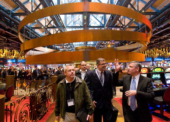 Sands Casino President Robert DeSalvio (right), tours the casino floor with Glenn Welch (left) of Springfield, MA, President of Hampden Bank and Anthony Poore of New Hampshire, Senior Community Development Analyst with the Federal Reserve Bank in Boston, here with a delegation from the greater Springfield Massachusetts area on Thursday.