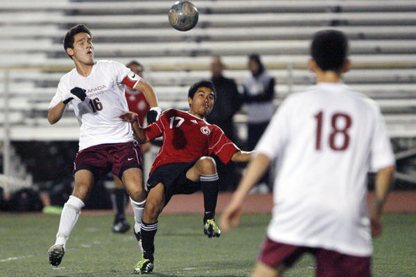 La Canada's Aidan Tourani, left, and Glendale's Albert Chamagua fight for the ball during a game at La Canada High School on Friday, December 28, 2012.