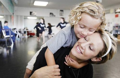 Cami Marseille gives her son Kai a hug during a a dance rehearsal for her dance team Orchesis on June 1. The show that the team put on in June was be a fundraiser for auutism. which Kai has.