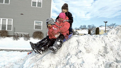The three sled riders are Karin Jackson, 6, Kella Jackson, 7, and Tia Miller, 9. They are the children of Fred and Tara Miller of Somerset, and they were playing near their home.
