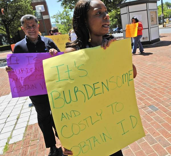 July 25, 2012: Tanya Robinson of Allentown protests the PA Voter ID law that requires voters to present valid photo ID to vote in the November election.