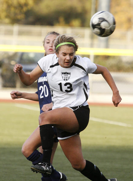 Sacred Heart's Claire Kostelnik heads the ball against Saugus' Avery Schulhofer in first half of the finals in a girls' soccer match at the Los Tacos Soccer Tournament at the Glendale Sports Complex on Friday, December 28, 2012. Saugus won the match in penalty kicks.
