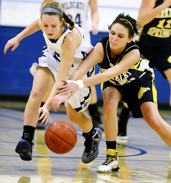 Williamsport's Kate Wade and Berkeley Springs' Casey Solomon chase a loose ball in the second quarter Friday in a Doub Ladies Classic game at Williamsport.