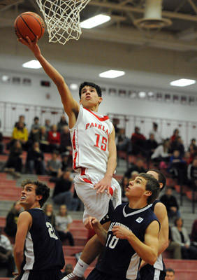 Parkland's Nick Rindock (center) drives to the basket in between Salisbury's Justin Aungst (left) and Tyler Cooperman (right) during their championship game during the Parkland Holiday Classic basketball game Friday night.