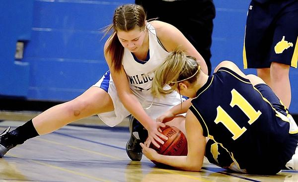 Williamsport's Carley Robinson and Berkeley Springs' Sydne Yanez battle for the ball in the second quarter of Friday's Doub Ladies Classic game in Williamsport.