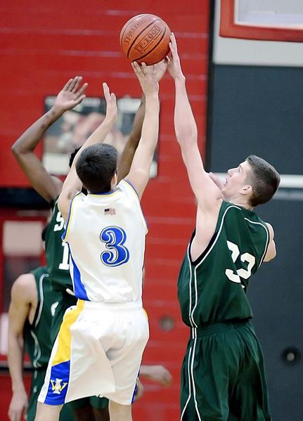Waynesboro's Seth Hoffman has his shot blocked by South Hagerstown's Kevin Henson in the second quarter of Friday's Hubs Holiday Classic game at North Hagerstown.