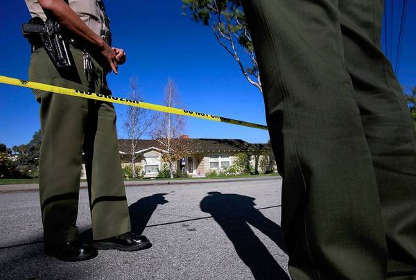 Los Angeles County sheriff's deputies outside the home of lawyer Jeffrey Tidus after his slaying in December 2009.