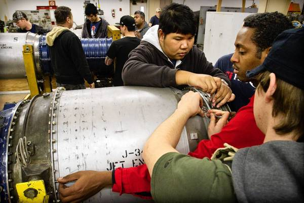 Students work on a jet engine at the aviation mechanics school at the North Valley Occupational Center-Aviation Center at Van Nuys Airport.