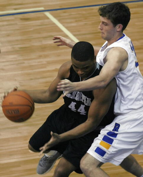 Hudson Price, right, shown here against Olympia, had 20 points and 14 rebounds in a loss for First Academy. (Stephen M. Dowell/ORLANDO SENTINEL)