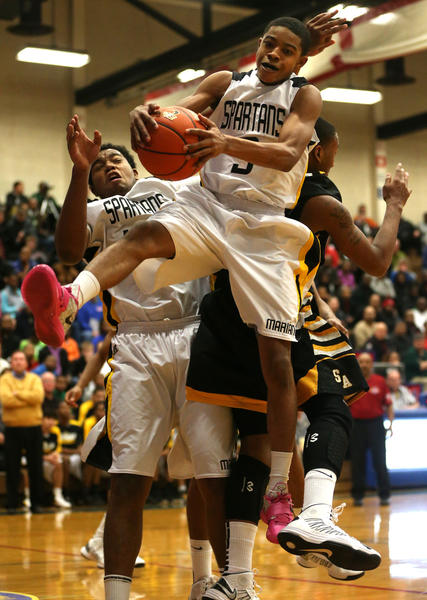 Marian Catholic's Tyler Ulis pulls down a rebound against Seton Academy in the semi-final of the McDipper tournament at Rich South in Richton Park on Friday, December 28, 2012.