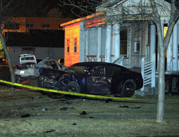 Two Aberdeen Police Department vehicles sit in the yard of 203 Seventh Ave. S.E. in the early morning hours of March 18, following a car accident at South Washington and Seventh Avenue. Ashley Elliott was riding in the white police car. American News File Photo by John Davis