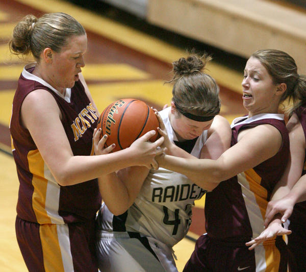 McIntosh's Jessica Werner, left and Kennedy Walking Elk, right, try to get the ball from Edmunds Central's Elaine Schaible during Friday's game at the Northern State University Wolves Basketball Classic at Wachs Arena.