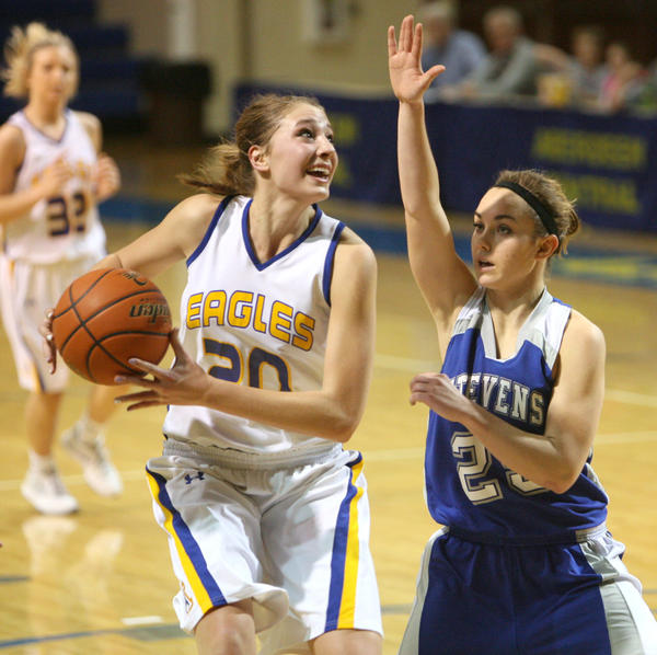 Aberdeen Central's Samantha Knecht, left, looks to the basket as Rapid City Stevens Gabby Haefs, right, defends during the first half of Friday night's game at the Golden Eagles Arena.