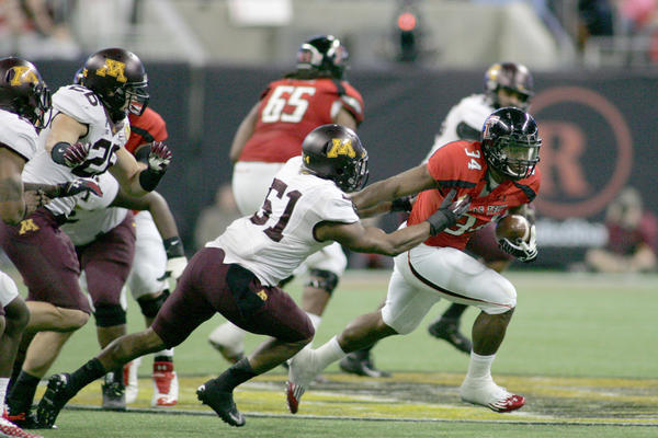 Texas Tech Red Raiders running back Kenny Williams (34) rushes against the Minnesota Gophers during the second half in the Meineke Car Care Bowl at Reliant Stadium.
