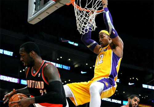 Dwight Howard dunks over Trail Blazers big man J.J. Hickson