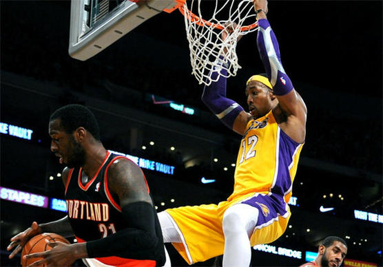 Dwight Howard dunks over Trail Blazers big man J.J. Hi