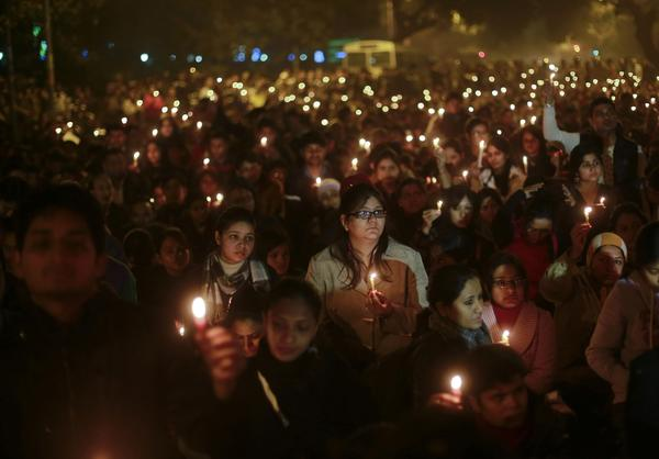 Demonstrators hold candles during a candlelight vigil for a gang rape victim who was assaulted in New Delhi December 29, 2012. A woman whose gang rape provoked protests and a rare national debate about violence against women in India died from her injuries on Saturday, prompting promises of action from government that has struggled to respond to public outrage.