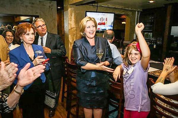 State Representative, District 30 candidate Karen Castor Dentel reacts with campaign manager Candy Crawford and daughter Caroline as poll results come in at the SoNapa Grill in Maitland, Fla. on Tuesday, November 06, 2012.