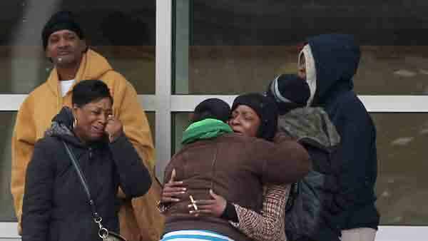 Shelia Johnson, the mother of the woman who died in a Lawndale fire Saturday, is hugged by family members outside the hospital Saturday.