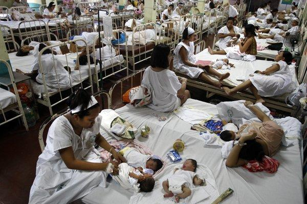 Even in the low season there are more than two women per bed in the recovery room of Dr. Jose Fabella Memorial Hospital in Manila, shown in this 2009 photo. The Philippines has the highest birthrates in Southeast Asia.