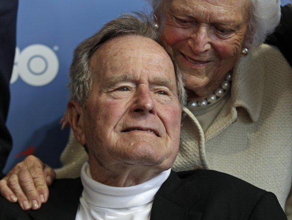 Former President George H.W. Bush, shown in June with wife Barbara, has been moved into a regular patient room at Methodist Hospital in Houston.
