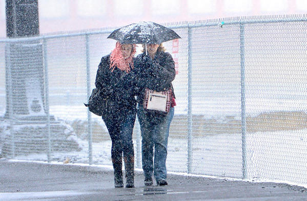 Nicole Paller of Allentown, left, and her mother Debbie Paller of Allentown walk to Steelstacks in Bethlehem Saturday afternoon. Four to six inches of snow are expected for the Lehigh Valley area Saturday.