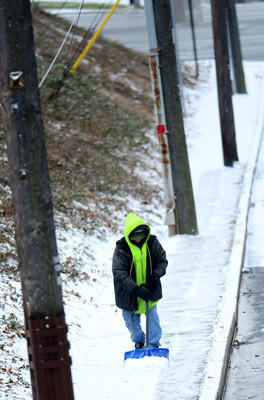 Chris Leiby of Catasauqua who works for the Whitehall Mall clears snow along Mickley Road near MacArthur Road Saturday morning. Four to six inches of snow are expected for the Lehigh Valley area Saturday.