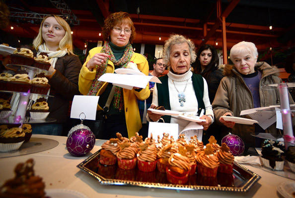 Sampling cupcakes at the Cupcake Bowl at Musikfest Cafe are, from left: Rebecca Yaple of Virginia Beach, Va., her mother Sue Yaple of Bethlehem; Mary Ann Gazey of Allentown and Yolanda Caliendo of Northampton. Members of the public judged area bakeries' best cupcakes Saturday at Musikfest Cafe at SteelStacks.